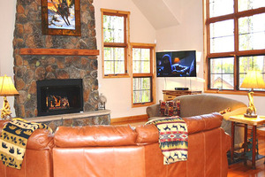 Family room, fireplace and mountain view.