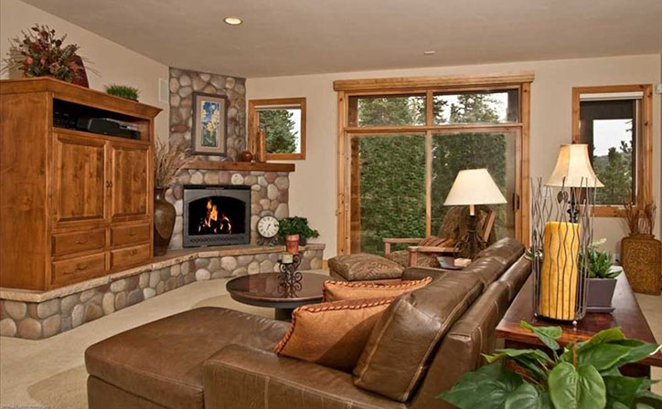 Downstairs family room with TV, Stereo, and Fireplace