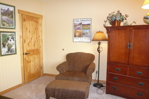 Guest BR with cozy reading chair.