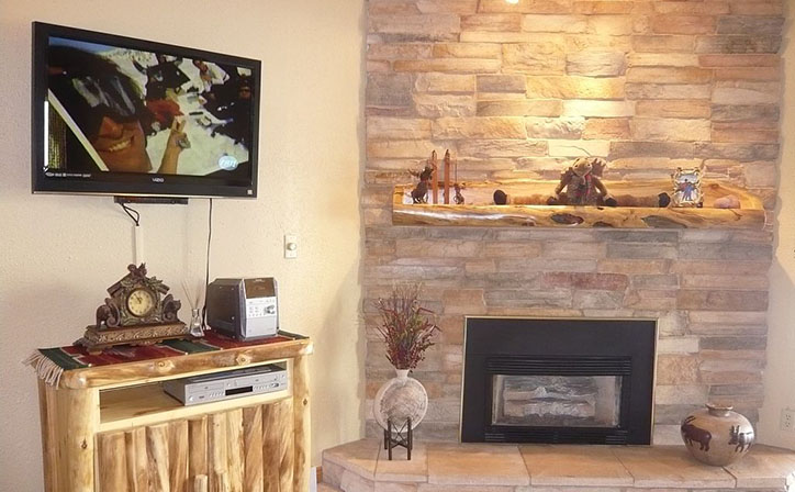 TV and fireplace and stereo cabinet.