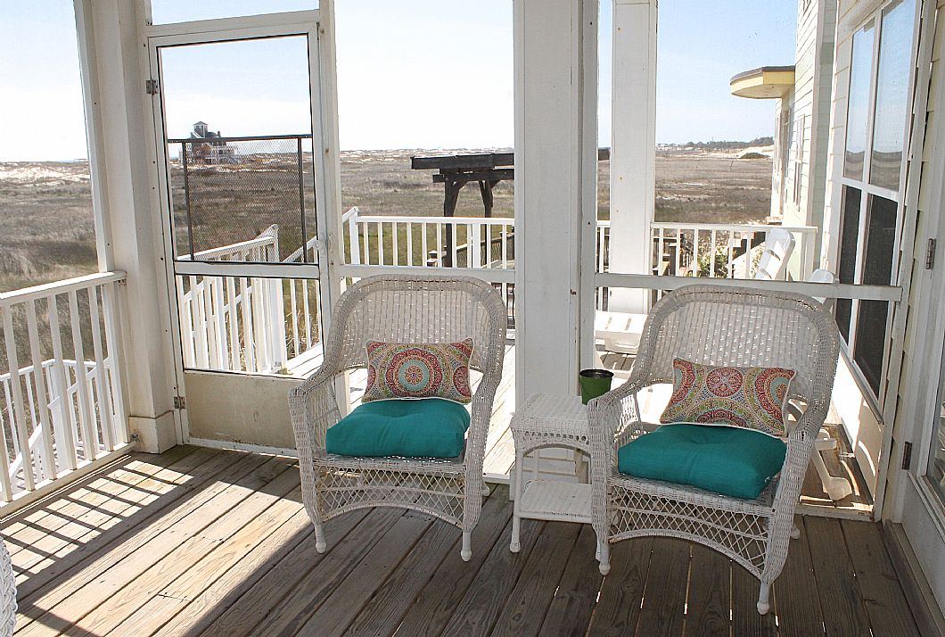 Extra seating on screened in balcony
