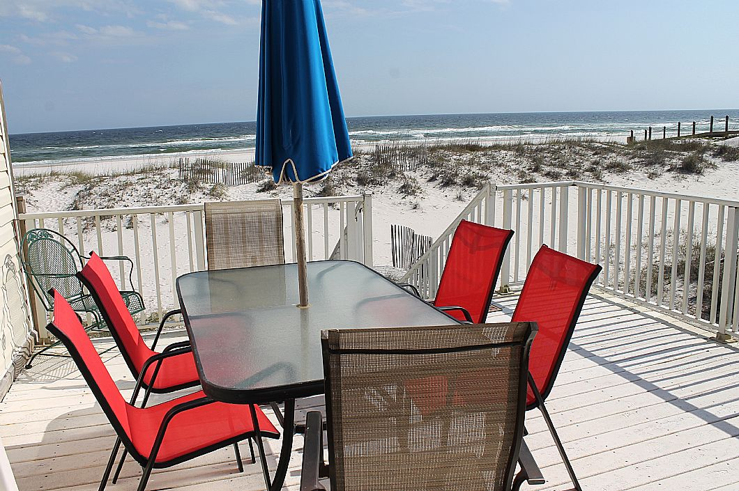 Private deck with seating to enjoy the sun & waves