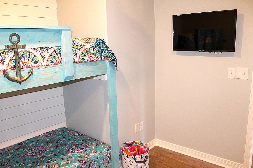 Mounted flat screen HDTV in bunk room