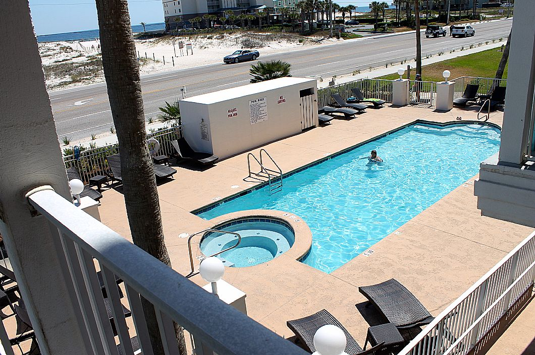 View of community pool & hot tub from balcony
