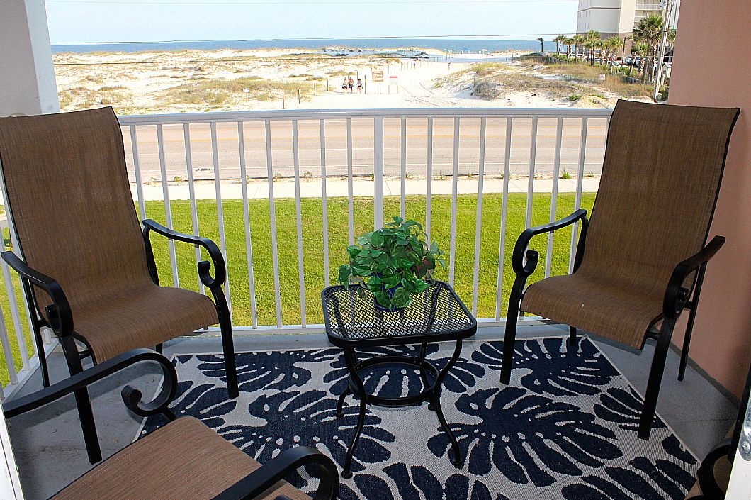 Private balcony w/ seating for 4
