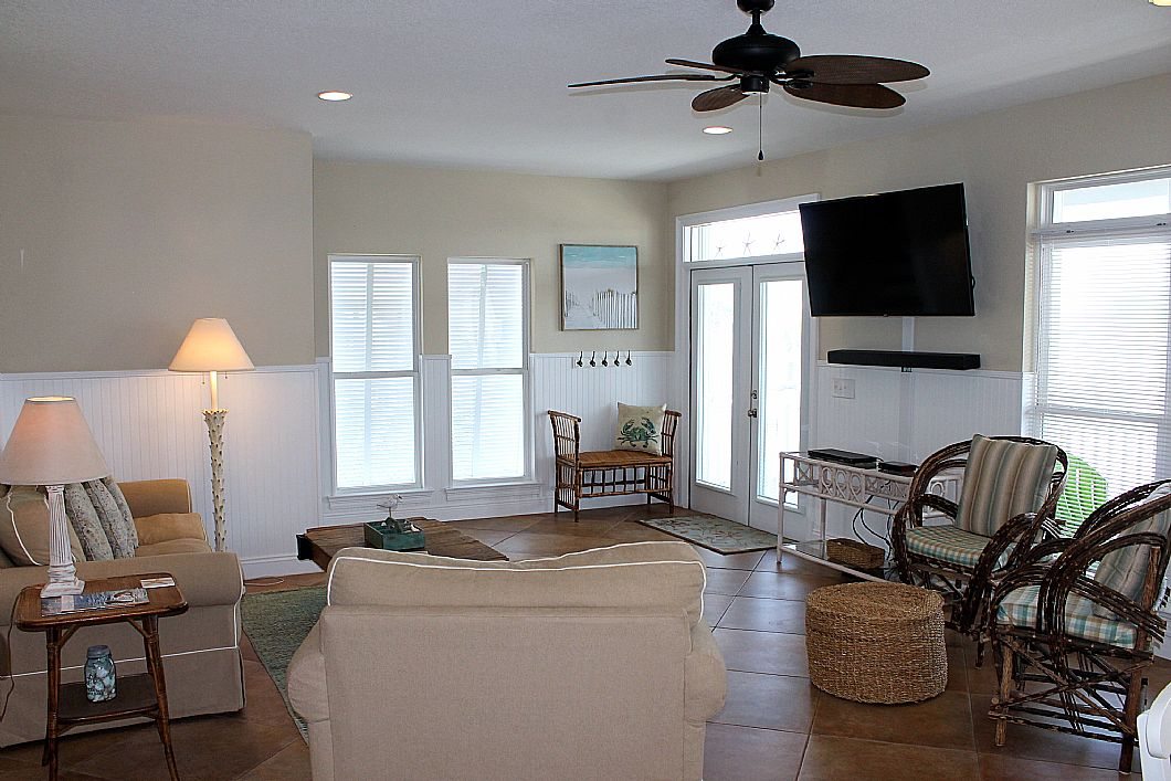 Living room has large mounted HDTV