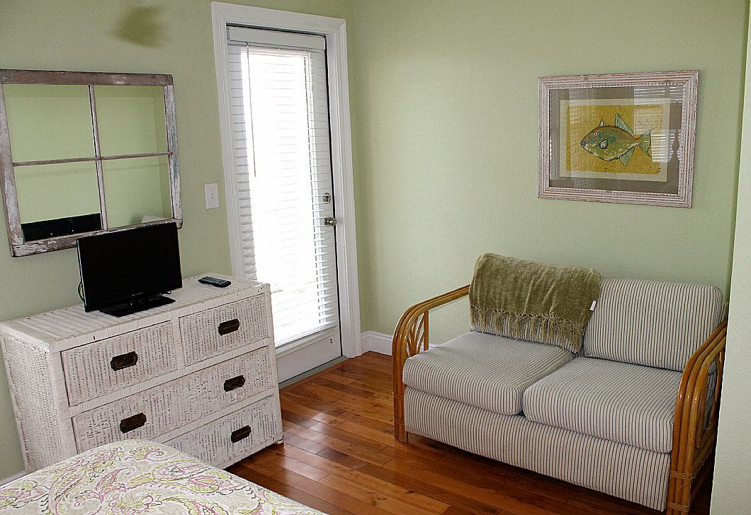 Love seat, tv, and balcony access - upstairs queen