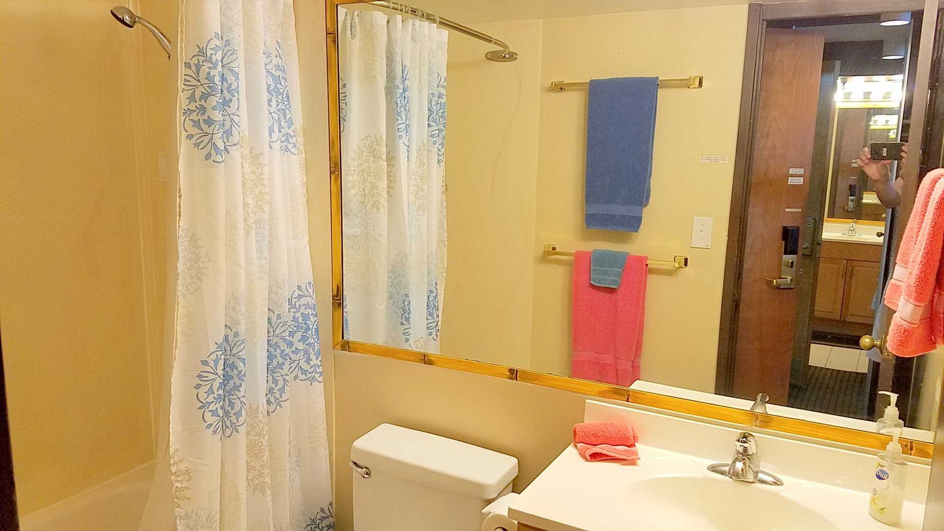 The bathroom includes a full-size tub/shower and hair dryer.