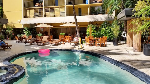 The pool area is charming and spacious