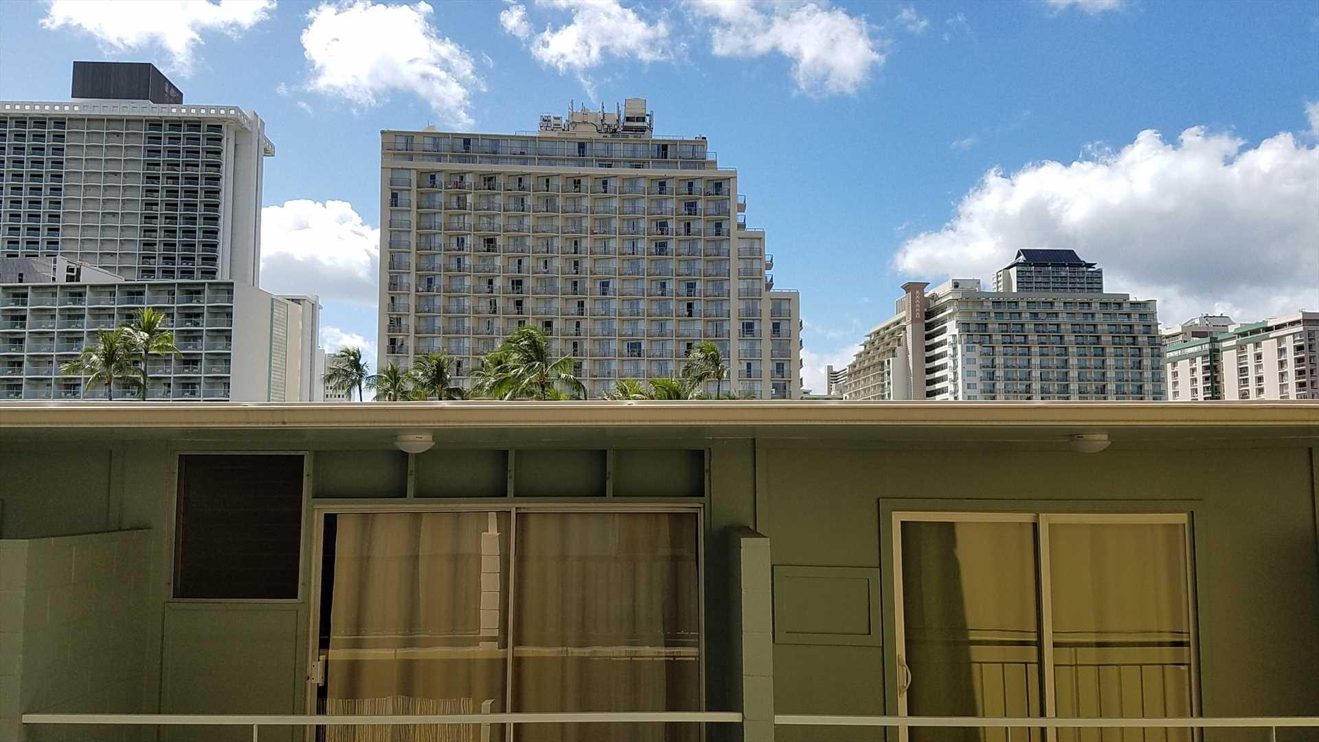 There is a skyline view from the lanai over the top of the newly renovated hotel next door.  For your convenience, we've installed a privacy film on the lower portion of the sliding glass door, so you do not need to keep the curtains closed.  (Hopefully,