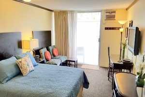 Spacious room includes comfortable Queen bed, Free wireless internet in the room, (and at the pool area).