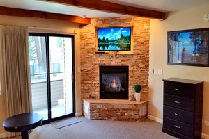 Built-in TV and DVD above fireplace