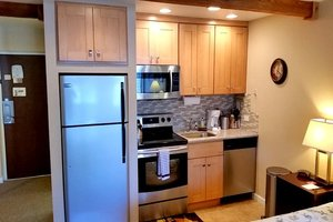 Kitchen with full-size appliances and granite countertop