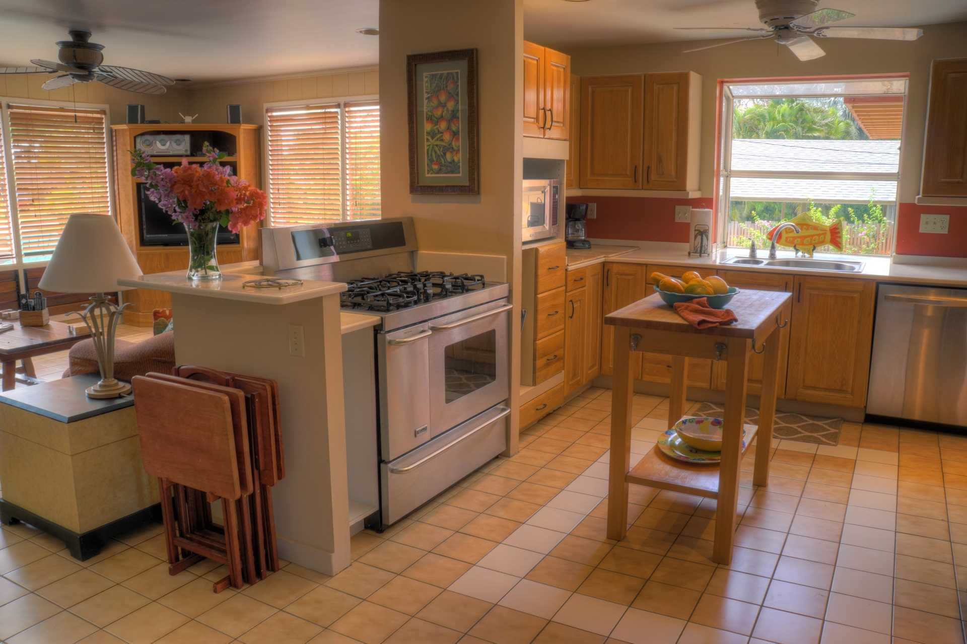 A fully equipped kitchen with corian tops and island cutting board provide ample space to create your gourmet meals