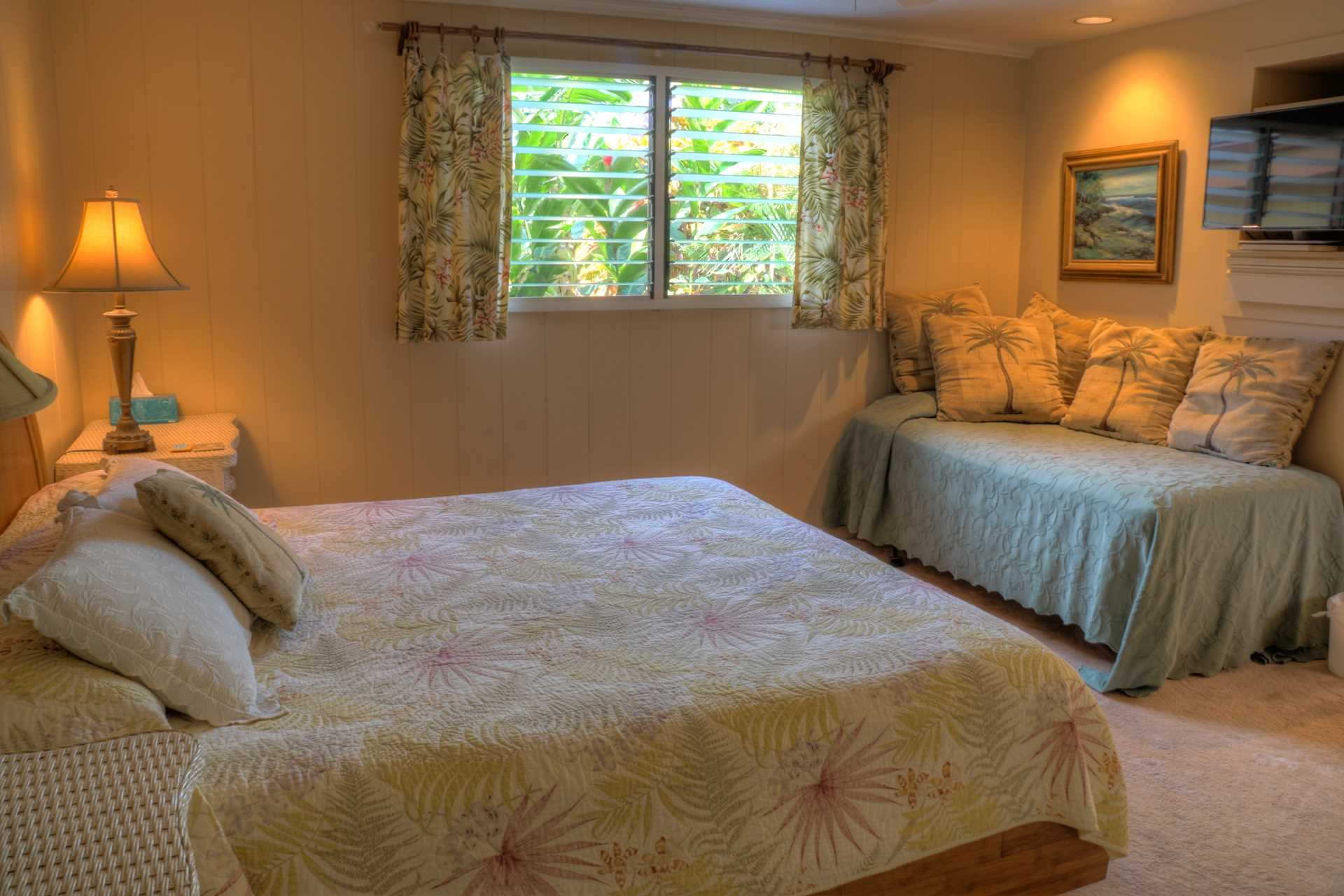 The lower master suite features a king bed with daybed and large master bath with walk in shower and dual vanities