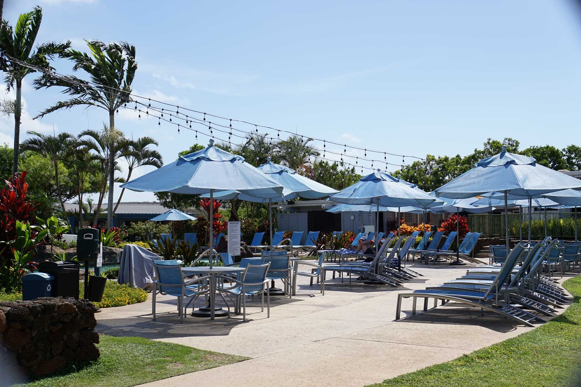 Relax deckside at Poipu Club, included with reservation