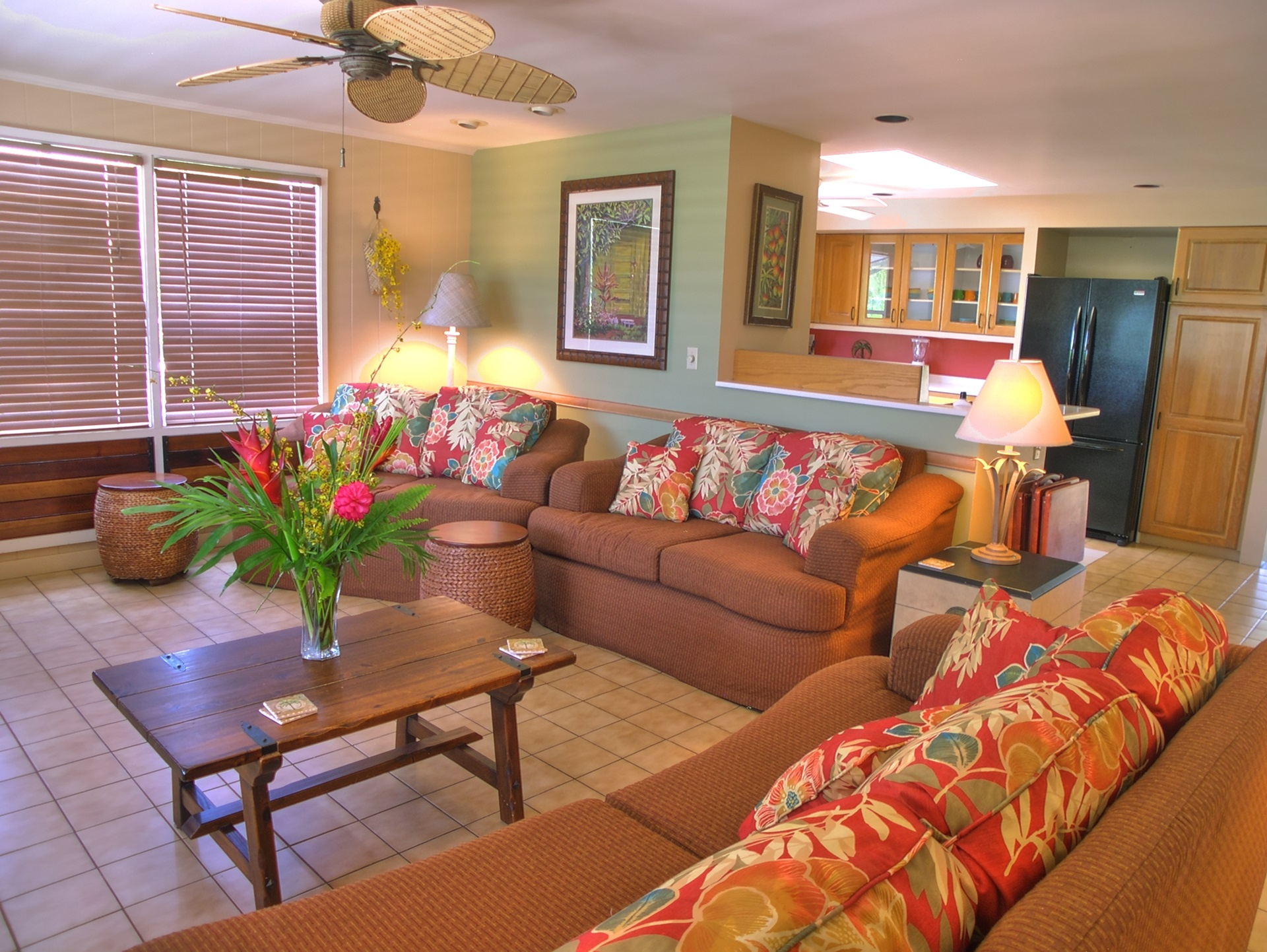 Tiled floors and an open floor plan blend the living, kitchen and dining areas.