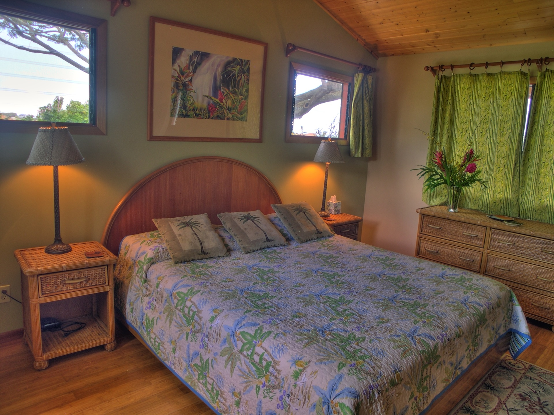"""The upper master suite is a delightful, airy room above the surrounding foliage, you even have an """"ocean glimpse""""."""