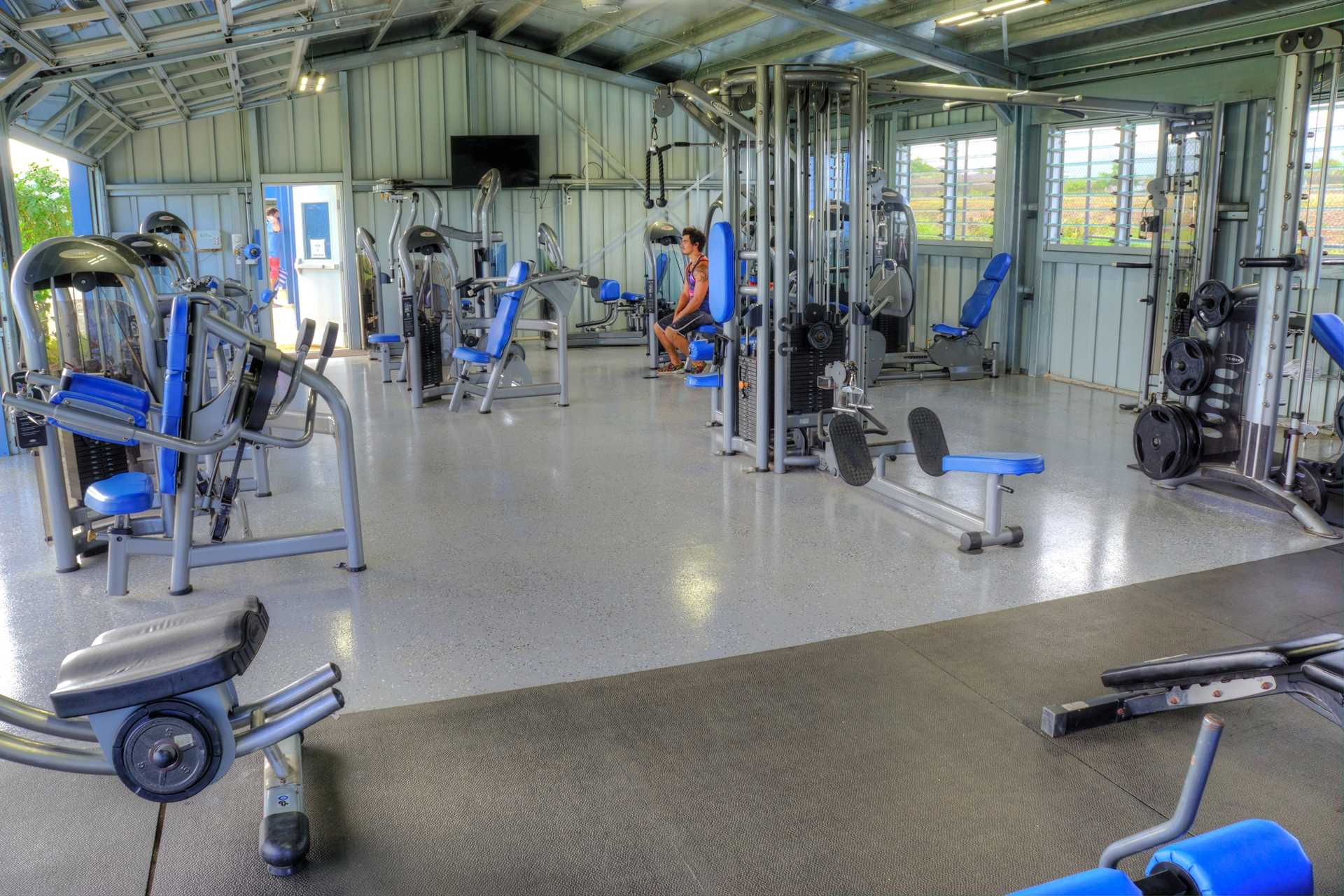 Weight room at Poipu Club, included with reservation
