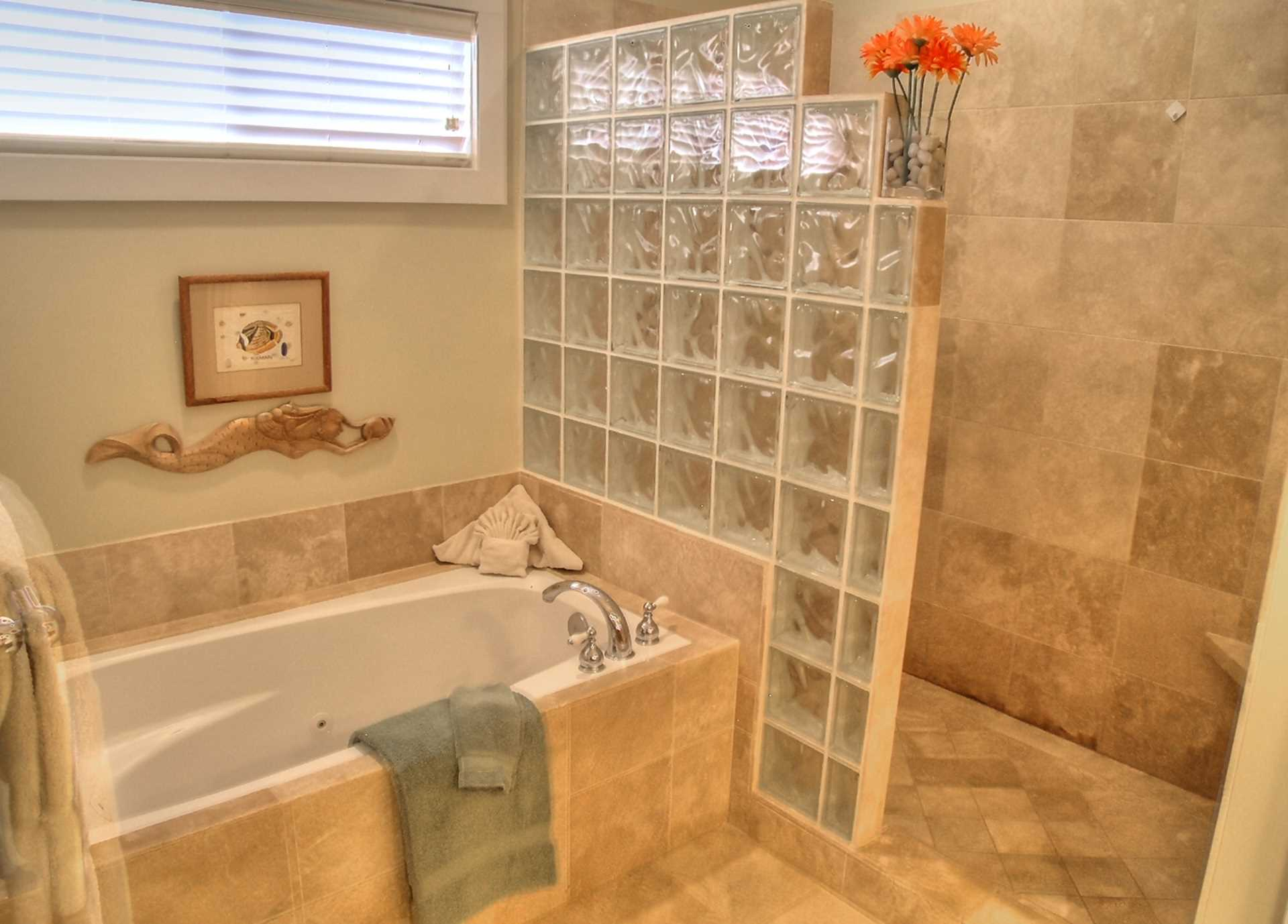 Master Bath Features a Jetted Tub, Walk-in Shower, Dual Vanity Sinks all in Travertine Tile and Glass Block