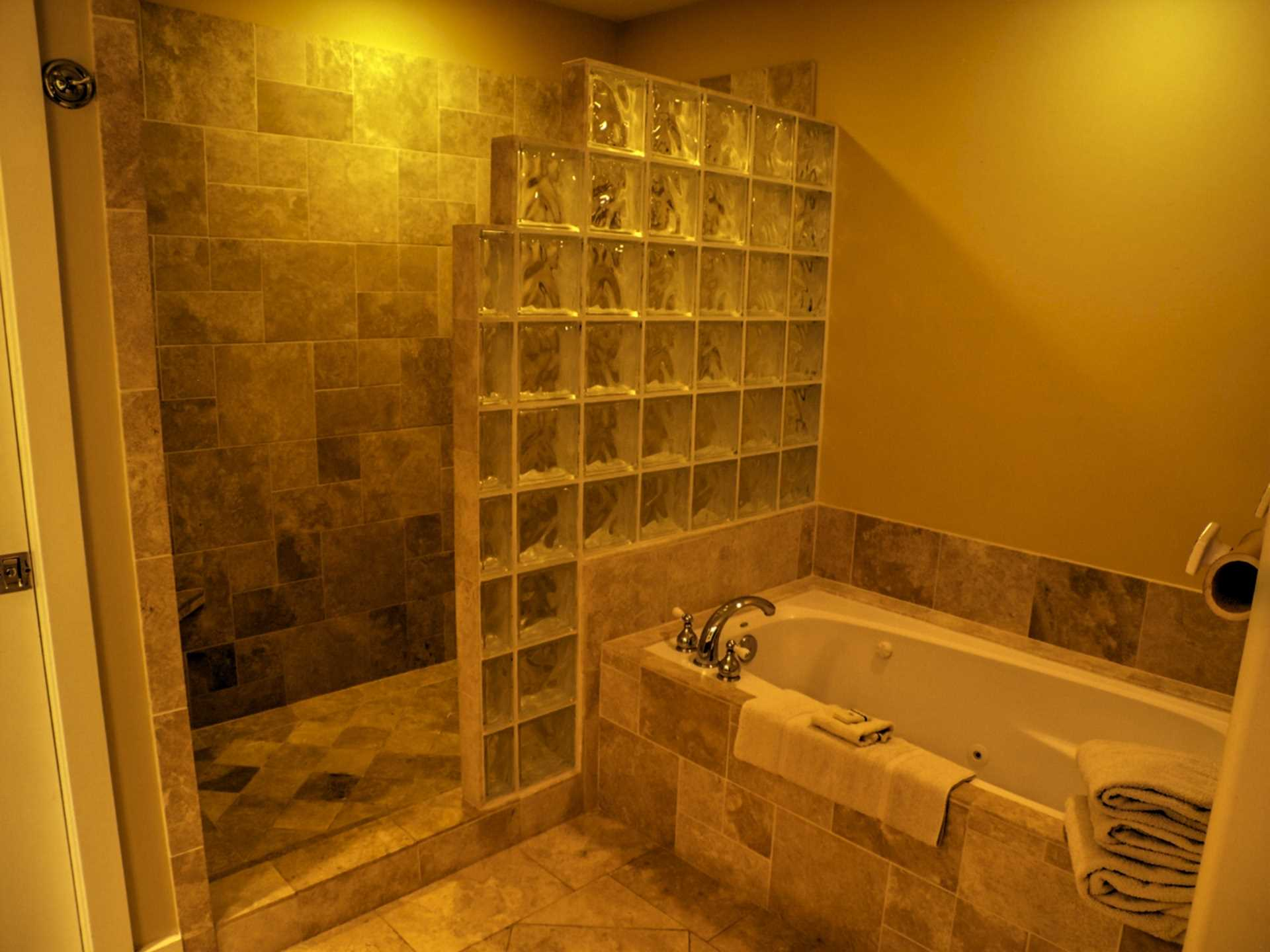 Master bath of travertine tile and glass block, two sink vanity