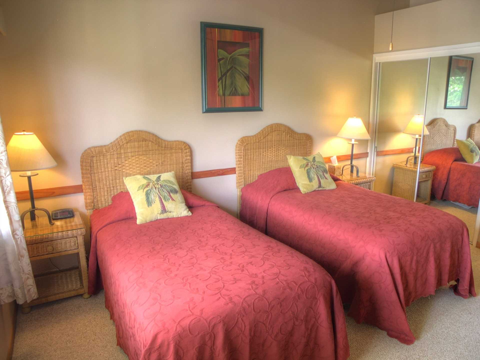 The guest bedroom has comfortable twin beds that can be converted into a king bed when needed. The full guest bath is just across the hall.