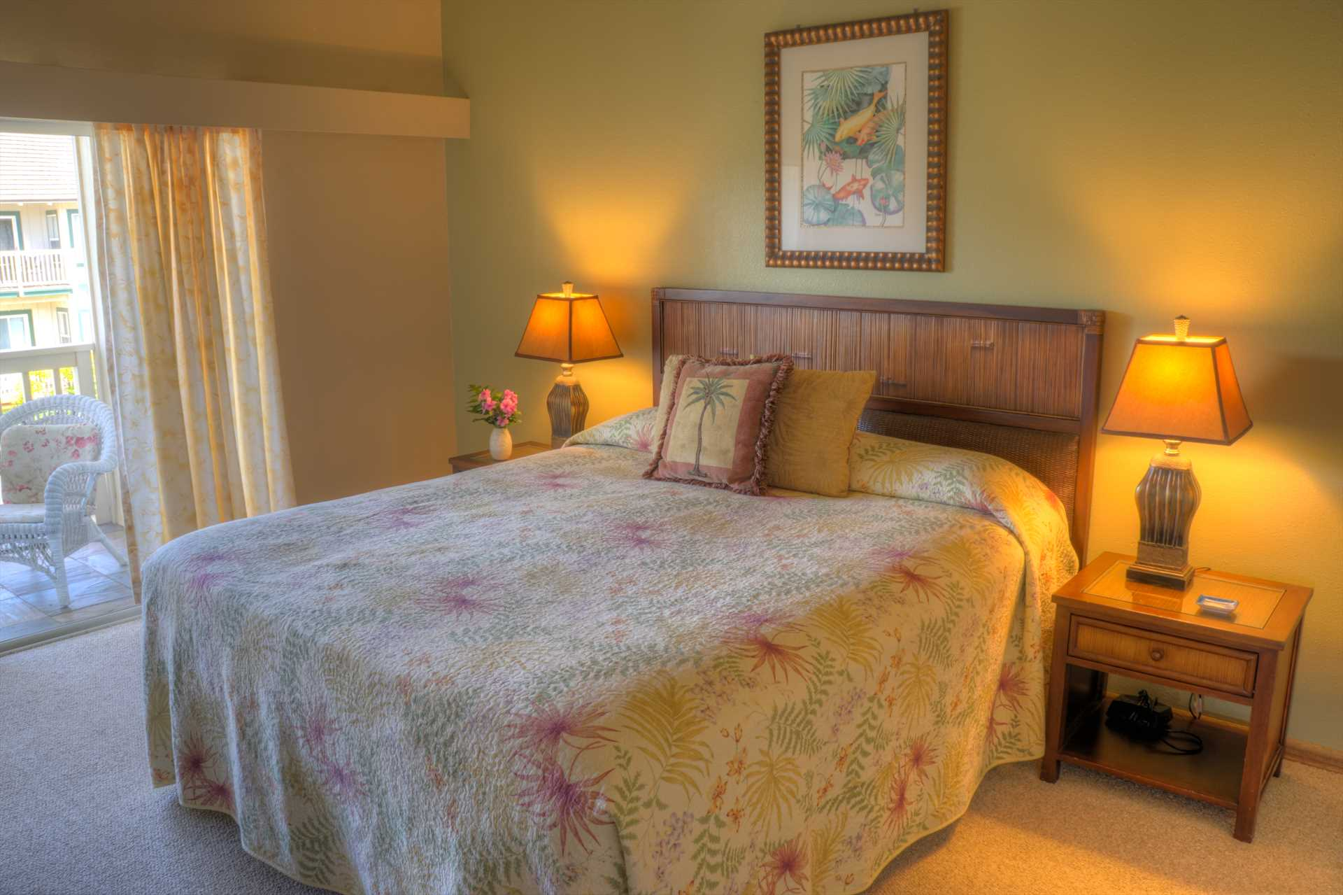 The master bedroom features a comfortable king bed, dresser, cable TV, ample closet space and a covered private lanai.