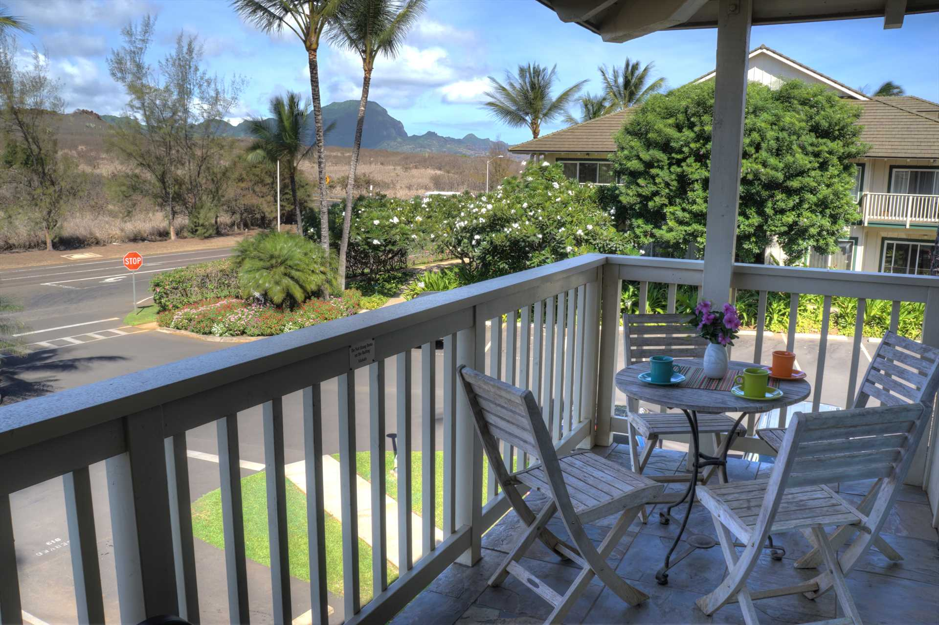 This is the view from the living room lanai. The mountain range in the distance is the Ha'upu range.