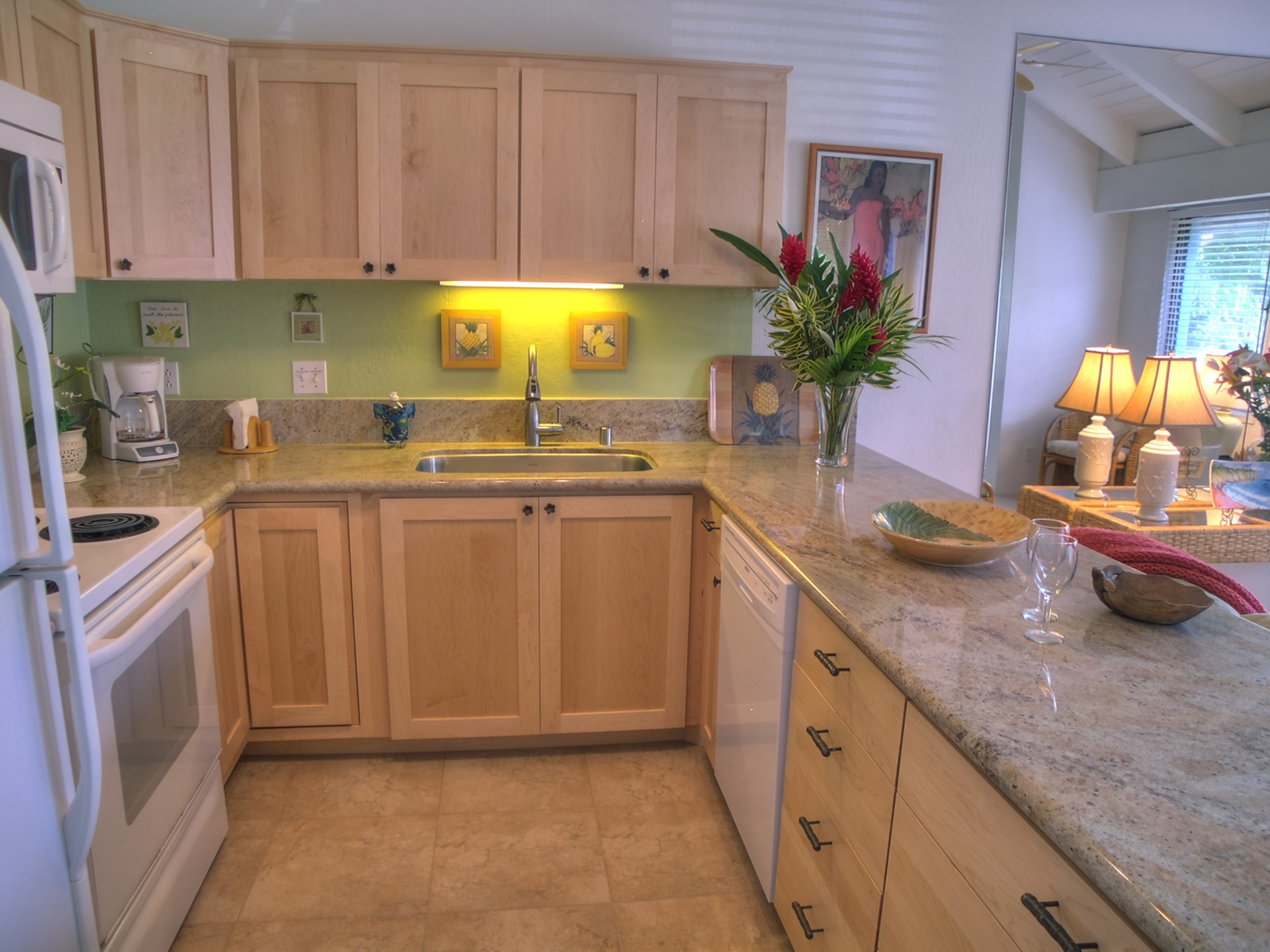 The fully equipped kitchen offers plenty of counter space to create your culinary island delights.