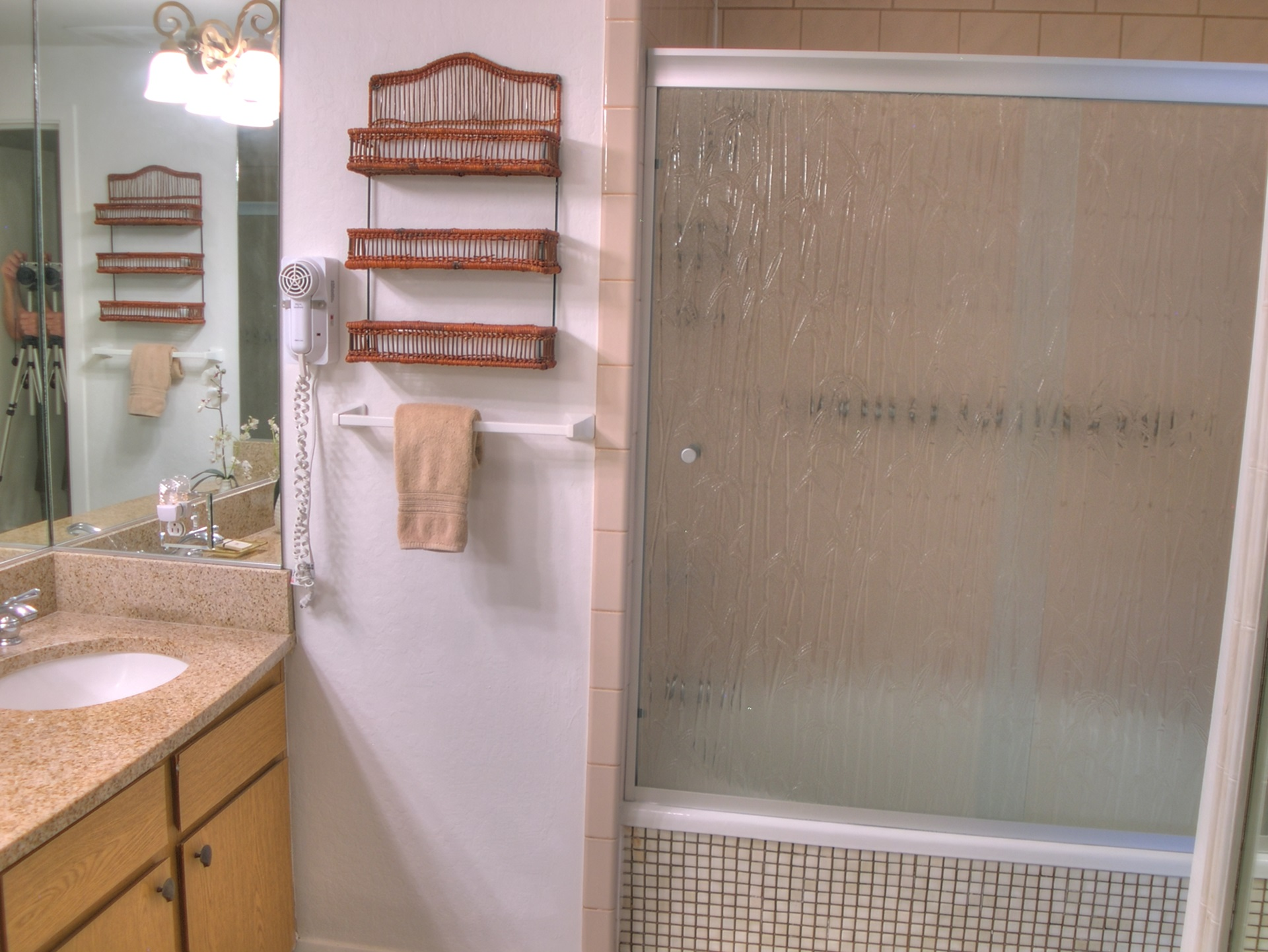 The master bath features a tub and shower and dual vanity sinks.
