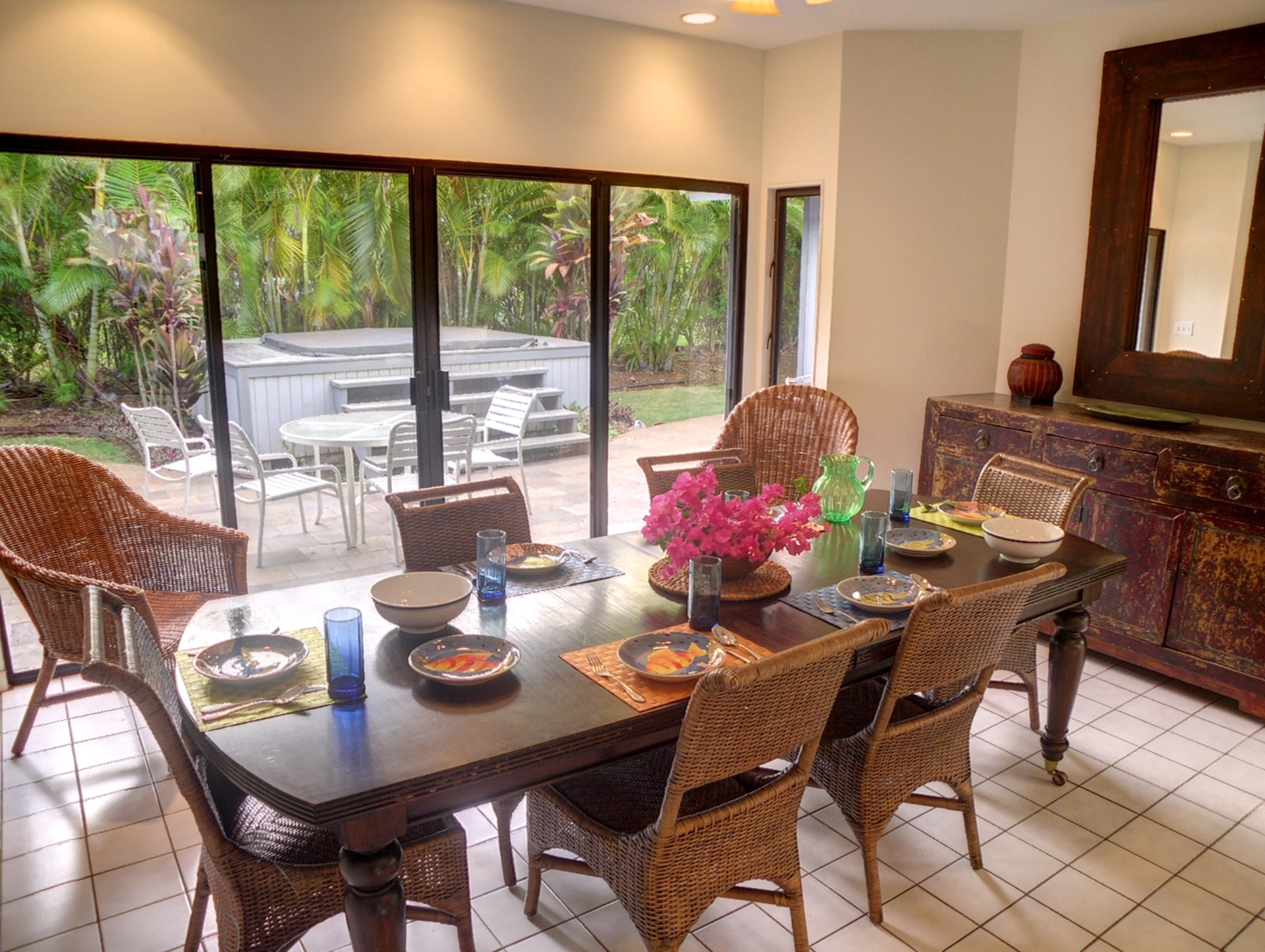 The dining room is located just off the kitchen and family room; It opens onto the large patio with double sliding doors.