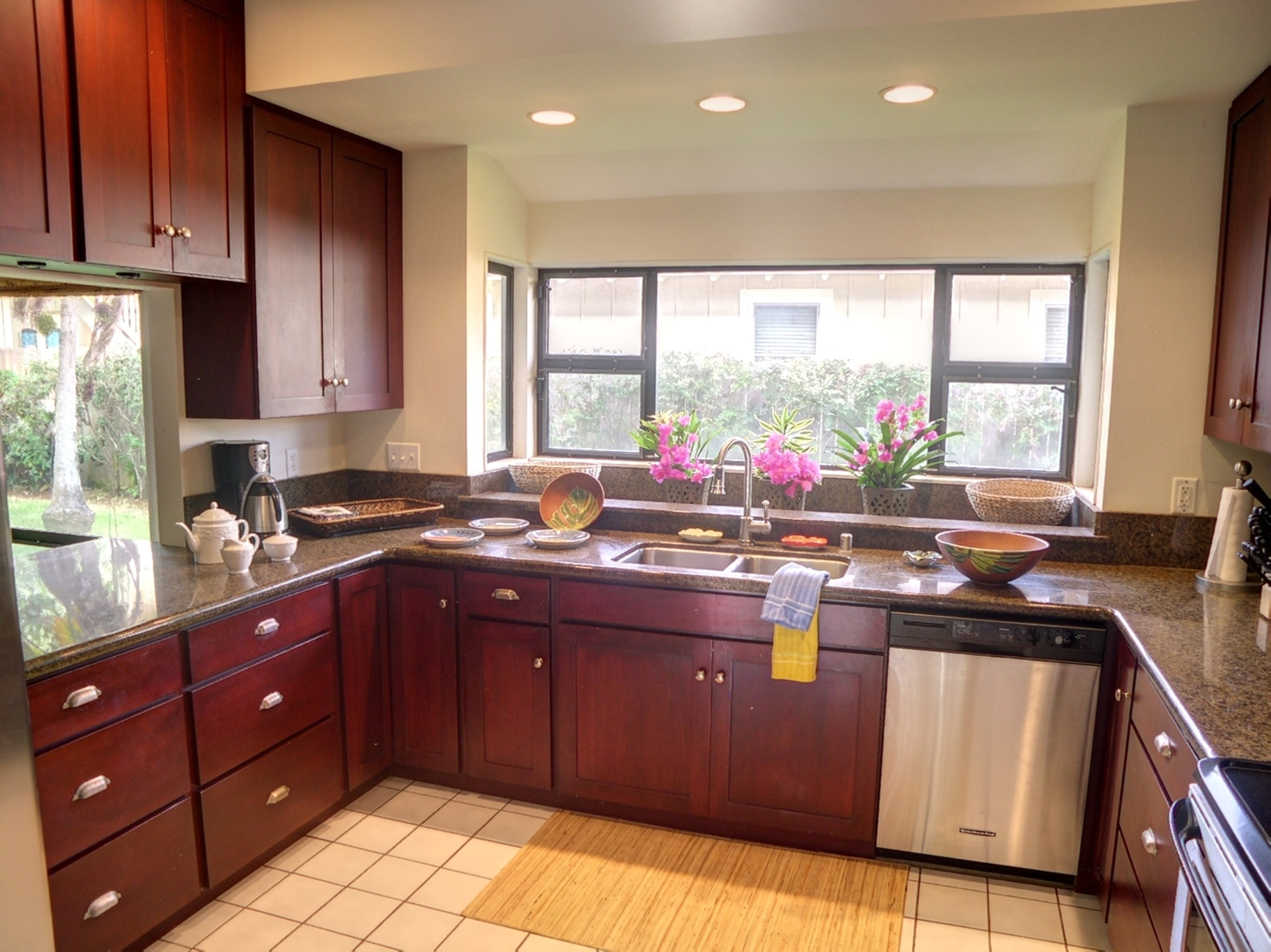 The kitchen is equipped with all you will need to create your island inspired culinary delights. Visit with friends in the family room via the convenient pass-through, or in the dining room just across the hall. You can keep an eye on the kids in the hot