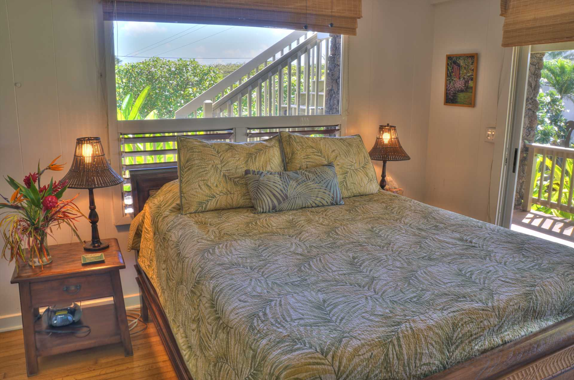 The master bedroom features a queen bed and private bath with access to the covered lanai