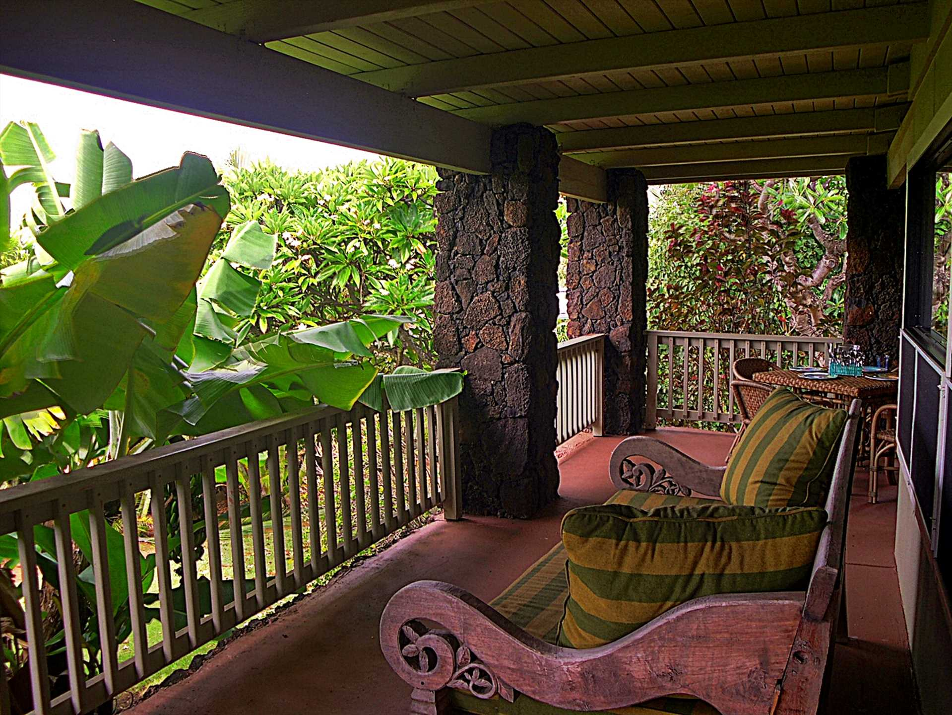 The wrap around covered lanai is a great place to relax and visit with friends.  The BBQ is just outside the sliding doors.