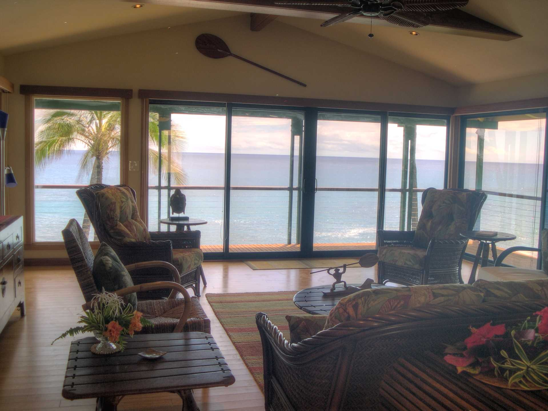Living room showing wrap around view of ocean