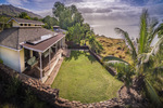 aerial view of this beachfront home