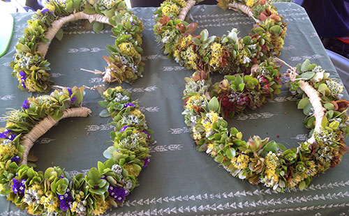 local flowers hand crafted into haku leis