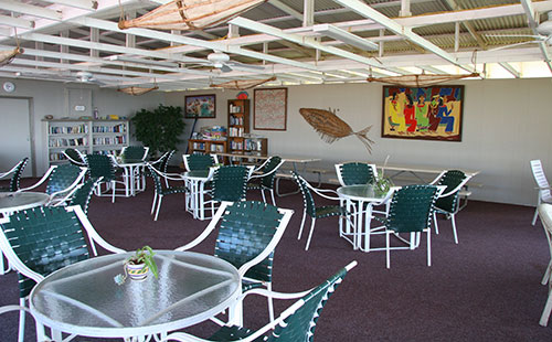 Covered dining and recreation area next to pool