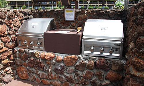 BBQ located in the grassy area in front of condos