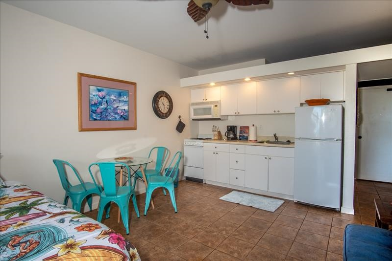 Cute Dining Table Next to Kitchen