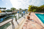 KRD - Holmes Beach - Pool and Dock - Beach House Real Estate