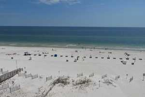 Miles of white sand for you to enjoy from this 6th floor balcony!