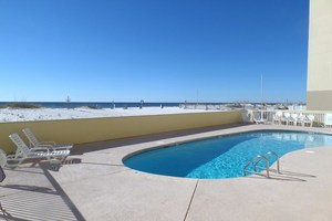 Relax at the outdoor pool during your Clearwater vacation
