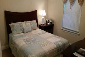 King-size bed in the master bedroom suite with attached bathroom