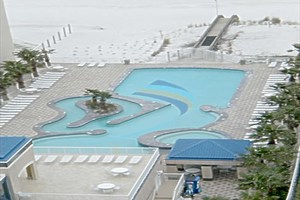Outdoor pool & beach access at Crystal Towers