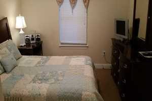 Queen-size bed in the second bedroom with flat-screen television
