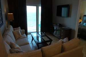 Relax in the living area and enjoy the large flat-screen television or the views from the balcony!