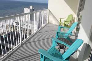 SIt out on this 18th floor balcony and, though Crystal Towers is across the street from the beach, you still have a view and can feel the salt air!