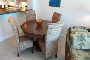 Sit, relax and enjoy a meal at the dining table during your stay at this Crystal Towers condo