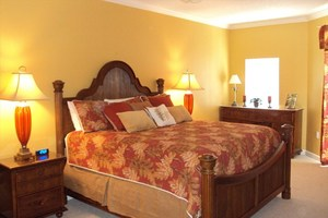 Master bedroom suite with king-size bed and balcony access
